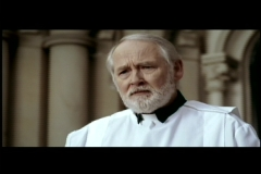 John Henley as The Priest in a Hot Docs commercial
