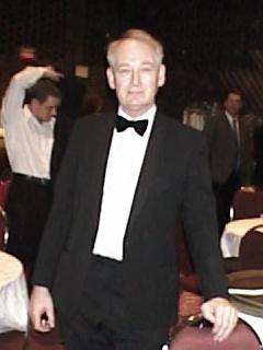 John Henley,Wardrobe: Modern black tuxedo